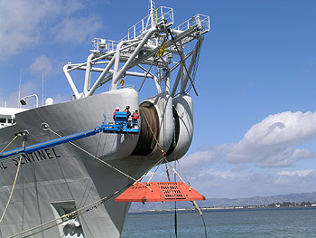 After laying the MARS observatory cable, the cable-laying ship Global Sentinel went to San Francisco Harbor pick up the trawl-resistant frame (orange object at bow of ship) that will protect the electronic