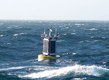 The new surface buoy rides the rough waters of the open ocean at the Shepard Meander Observatory, 100 kilometers from shore. Image: Kent Headley (c) 2006 MBARI