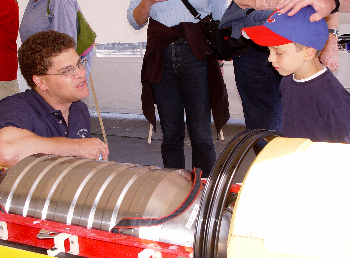 Engineer Hans Thomas discusses AUV design with a young visitor. Photo: Duane Thompson (c) 2004 MBARI