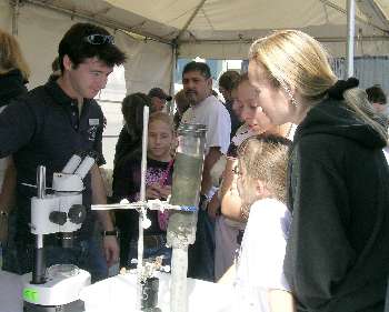 MBARI is a great place to learn about some of the interesting things that live in deep-sea mud. Here, biologist Christian Levesque explains his benthic biology work to visitors. Photo: Debbie Meyer (c) 2004 MBARI