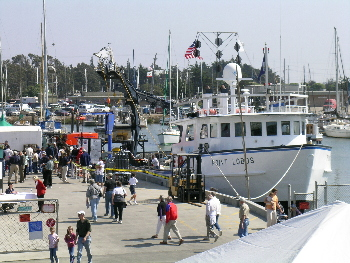 Visitors explore the MBARI docks, which are only open to the public during the annual Open House. Photo: Kim Fulton-Bennett (c) 2004 MBARI