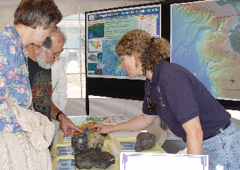 Geologist Jenny Paduan describes lava samples from the seafloor. Photo: Kim Fulton-Bennett (c) 2004 MBARI