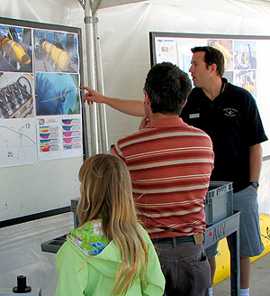 AUV Specialist Doug Conlin explains how an autonomous underwater vehicle (AUV) can find its way around Monterey Bay without without direct control from the surface. Photo: Duane Thompson (c) 2007 MBARI