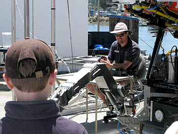 Remotely operated vehicle (ROV) pilot Mark Talkovic demonstrates the dexterity of ROV Ventana's manipulator arm. Photo: Duane Thompson (c) 2007 MBARI