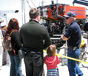 Knute Brekke, who pilots MBARI's remotely operated vehicle (ROV) Ventana, explains how a full-sized ROV works to visitors on MBARI's dock. Photo: Duane Thompson (c) 2007 MBARI