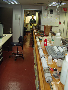 A newly assembled OsmoSampler array awaiting deployment 500 meters below the seafloor. This 7.6-meter-long array contains about 2,500 meters (8,000 feet) of coiled teflon and copper tubing. Before deployment, it will be inserted into a protective metal sleeve, then lowered to the sea bottom and into the borehole through the center of a 10-cm (4-inch) drill pipe. Photo: Hans Jannash (c) 2004 MBARI