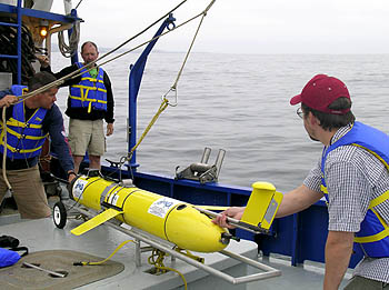 Researchers from Alaskan Native Technologies launch an undersea glider equipped with sensitive underwater microphones as part of the PLUSNet experiment. Image: (c) 2006 MBARI