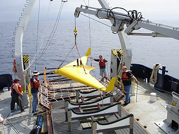 The XRay glider, a newly designed, high-performance undersea robotic vehicle from Scripps Institution of Oceanography and the University of Washington, is readied for a trial run as part of the PLUSNet experiment. Image: (c) 2006 University of Washington
