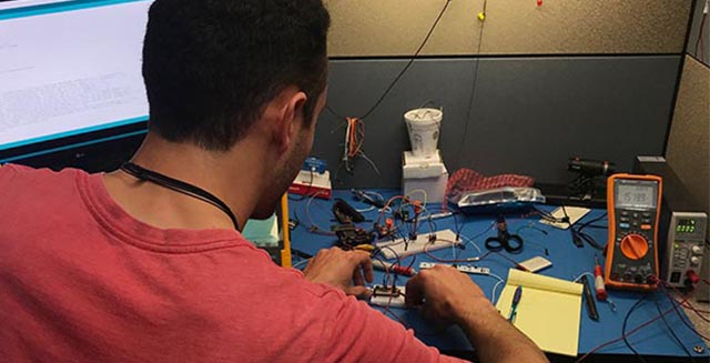 Santos Elizondo working on electronics.